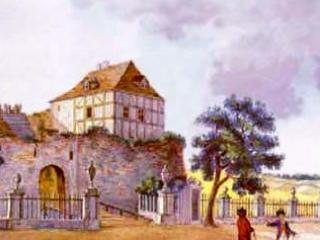 Widok zamku z istniejacym ogrodzeniem